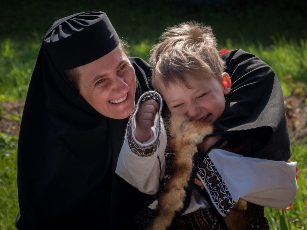 Nun and Boy at church in Bucovina