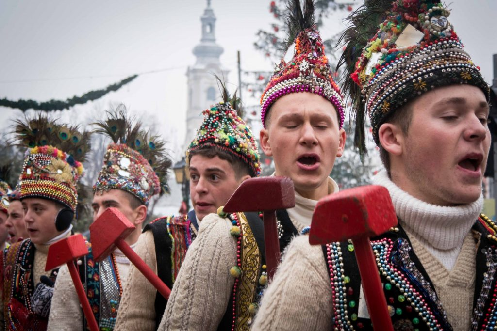 People dresses in traditional clothes at a winter festival