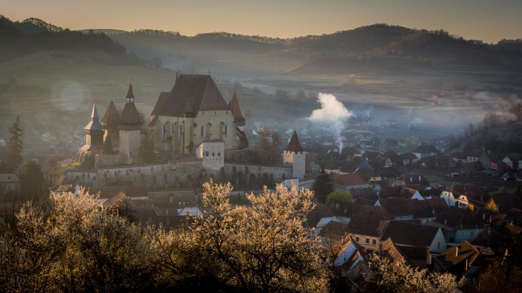 Fortified churches bathed in the early morning sunlight, soft and diffuse - Biertan