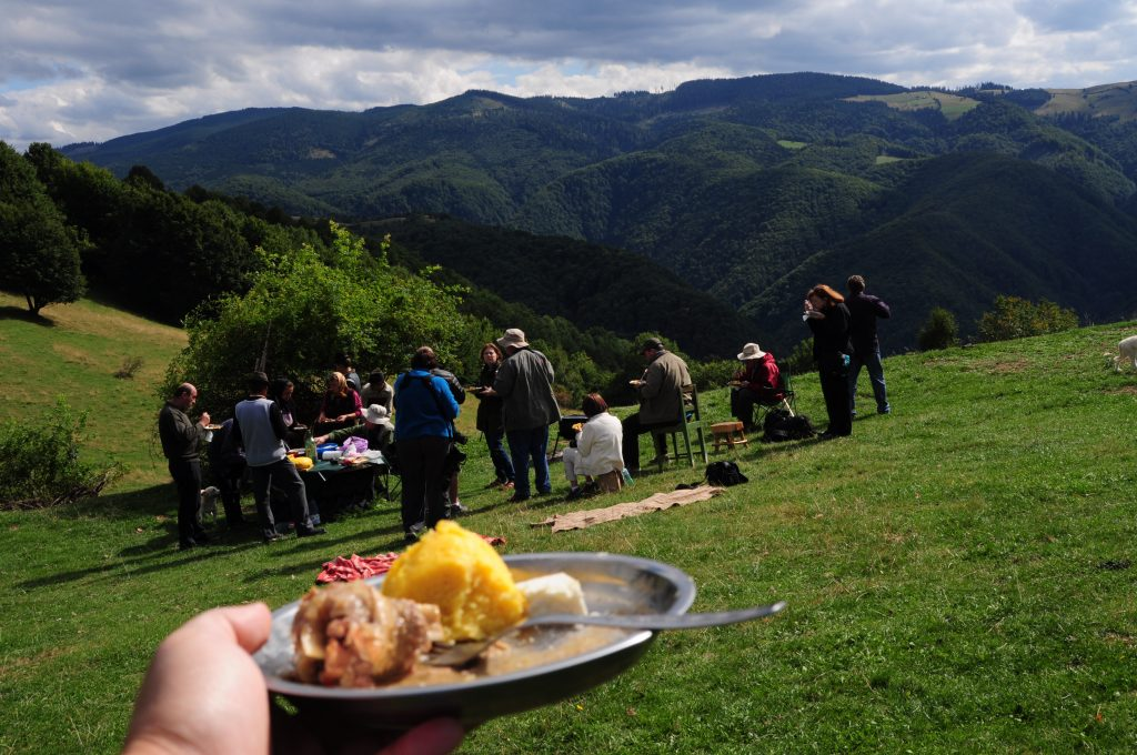 People enjoying a meal at a sheepfold